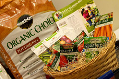 Miracle-Gro Organic potting mix and seed packets.